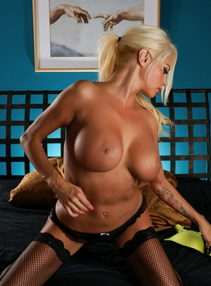 Big titted blonde Nikita Von James gives blows a huge cock before riding it
