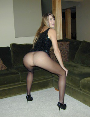 Leggy girl Adrienne Manning gives jerk off instructions in see thru pantyhose