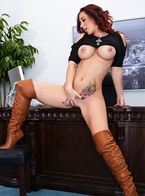 Hot redhead Jayden Jaymes showing big tits  toying wearing sexy high boots