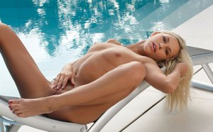 Bare foot Dido A with legs spread showing tight ass & bald pussy by the pool
