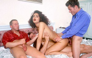 Cock starved slut with retro hairdo does anal while fucking 3 guys at once