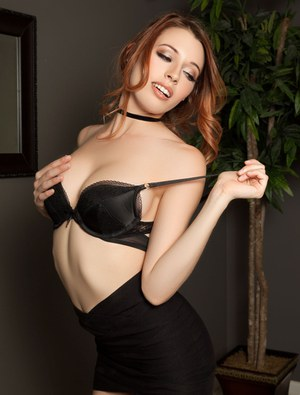 Hot centerfold Caitlin McSwain sheds short skirt to pose naked in high heels