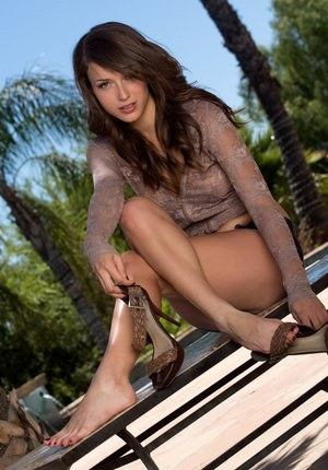 Sultry Malena Morgan stripping her short and toying on the patio table