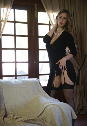 Glamour model Stella Cox takes off her little black dress and sexy bra