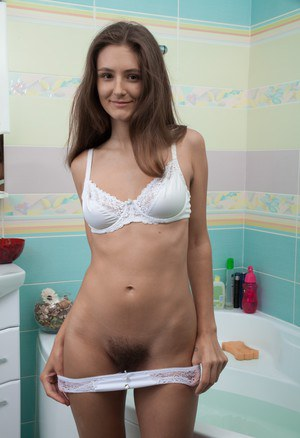 Amateur model Shivali baring hairy muff and saggy tits in the bathtub
