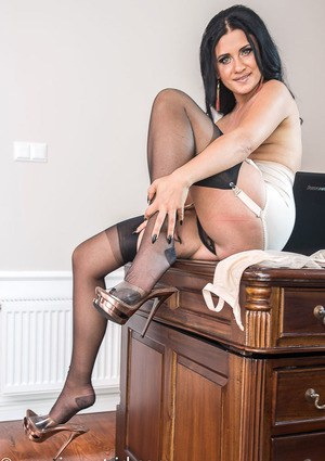 Dark haired lady Amazing Astrid teases her her twat in nylons and heels