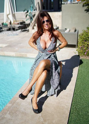 Sexy busty Wifey drops her dress outdoors to sun her massive big boobs