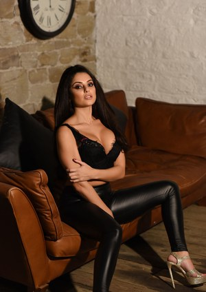 British model Charley S exposes her nice tits in tight leather pants