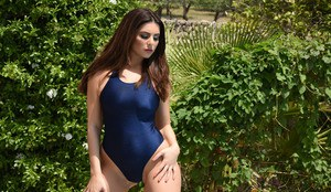 Latina glamour model Charley S releases her big boobs from her swimsuit