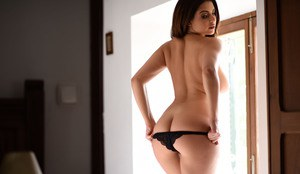 Beautiful Latina Charley S peels down to her sexy black panties all alone