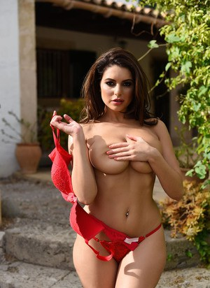 Beautiful brunette Charley S removes her red bra to sun her sexy big boobs