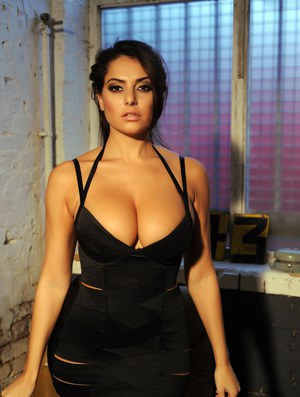 Sultry Latina Charley S peels her skimpy black dress to sun her big tits