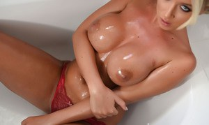 British glamour model Stacey Robyn covers her big tits and ass with oil