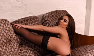 British model Lauren Louise removes black lingerie to pose nude in stockings