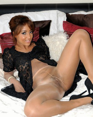 Hot package Kayla wears silk sheer pantyhose while toying her horny wet pussy