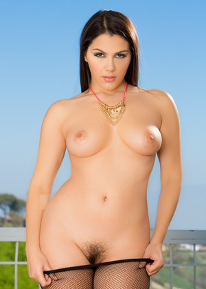 Pantyhose wearing Valentina Nappi undressing to bare her hairy muff outside