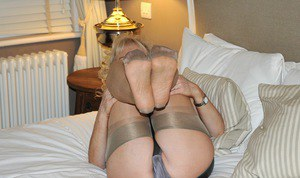 Hotmature Nylon Sue flaunt sexy feet topless in stockings on her knees