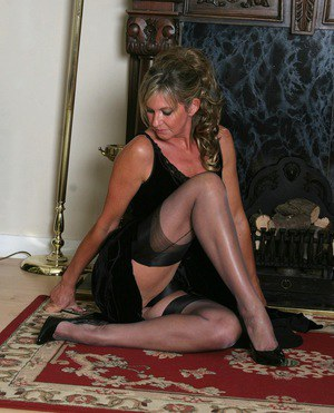 Classy older broad Satin Jayde models in sexy lingerie and nylons