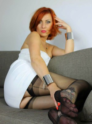 Redhead MILF Vixen Nylons plucks a cherry off plate with nylon encased feet