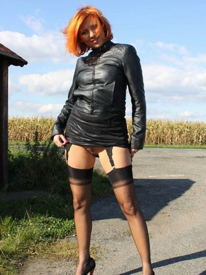 Dirty MILF in provocative leather outfit Vixen spreading ass cheeks in public
