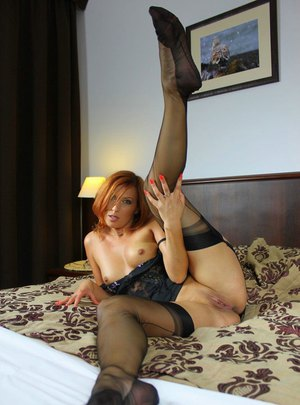 Red female shows off her wet pussy wearing back seam nylons