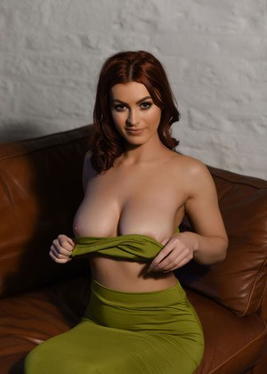 Natural redhead St Claire revealing perfect big boobs while stripping naked