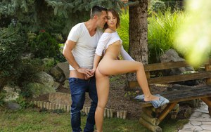 Cute chick Kira Thorn seduces her man for sex outdoors in jean shorts