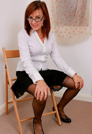 Glasses clad Georgie flashes panty upskirt before baring her bald pussy