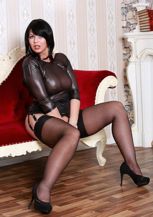 MILF Desyra peels her skin tight sheer top to sprawl in stockings & garter