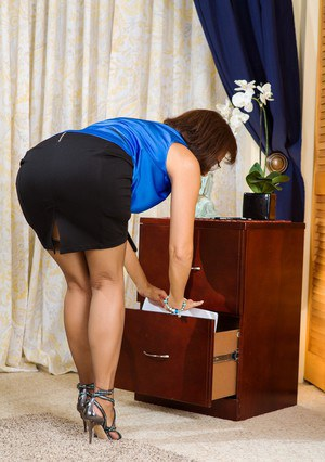 Classy businesswoman Roni Ford strips to nylons and garters in her home office