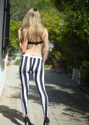 Naughty British girl pulls down her zebra pants on the sidewalk in heels