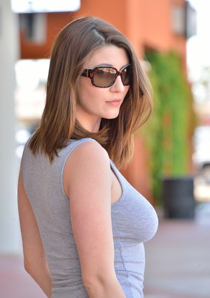 Leggy chick in sunglasses flashing no panty upskirt and big boobs on street