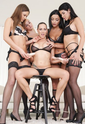 5 lesbians in their underwear and hosiery partake in a strapon orgy