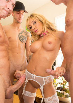 Blonde chick Amy Brooke gives a group of men oral sex at the same time