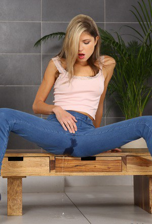 Sexy Gina Gerson pissing in her tight jeans and fingering her wet pussy