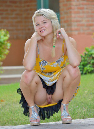 Cute girl in pigtails flashes naked upskirt on the porch and toys wit veggies