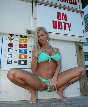 Blonde amateur Naughty Allie fills out a bikini in her bare feet