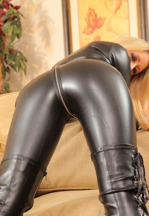Mistress Candice unzips hr leather catsuit to expose her nice tits