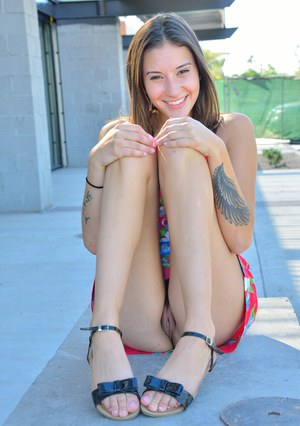 Horny teen girl wears no undoes so she can finger her beaver outdoors