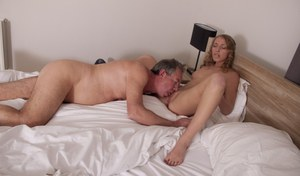 Young blonde kisses her sugar daddy before they engage in oral sex