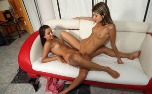 Two wonderful teenage babes having an intense lesbo sex on the sofa