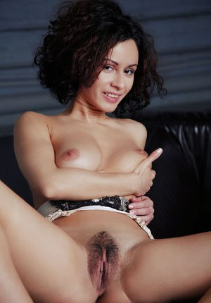 Dark haired chick Pammie Lee proudly displays her neatly trimmed muff