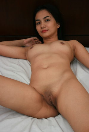 Dark haired Asian undresses for first time posing in the nude