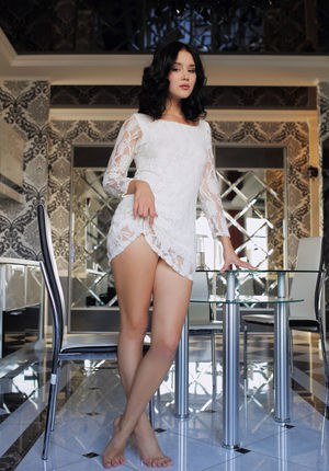 Dark haired Euro babe Malena strips down naked in the kitchen