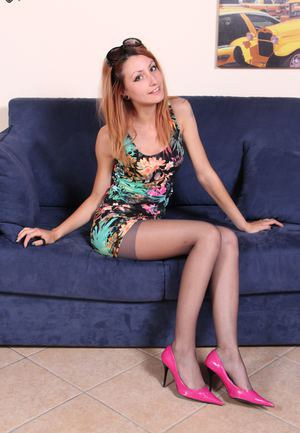 Gorgeous redhead shows her perfect feet and soles in black pantyhose