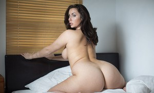 Brunette MILF pornstar Paige Turnah wakes up nude and horny from sleep