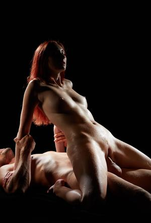 Redhead beauty with nice tits and her man friend fuck in the dark