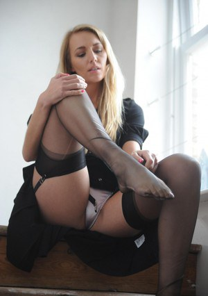 Sexy Hayley Marie Coppin spreads in black dress to flash her white panties