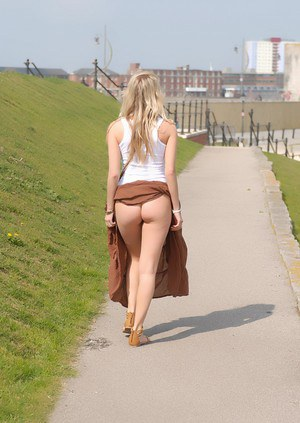 Solo girl Hayley Marie Coppin flashes her bare ass while walking on sidewalk