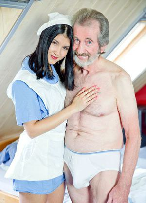 Dark haired nurse relieves her patient of his backed up jizz problem